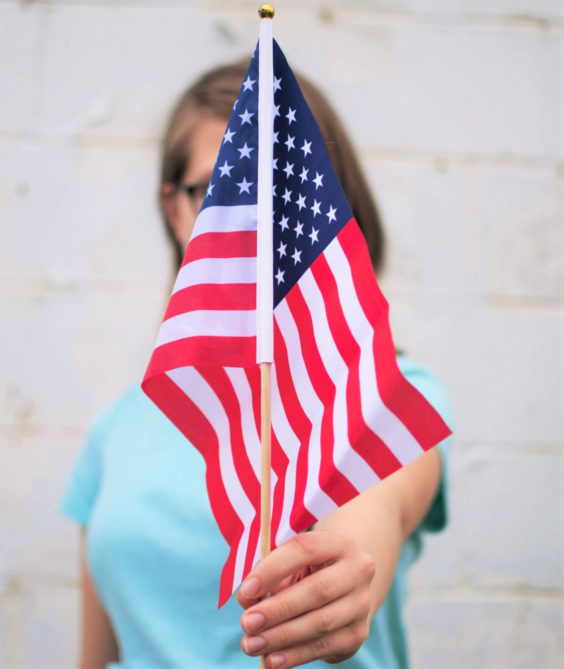 happy-July-4th-2021-girl-holding-american-flag
