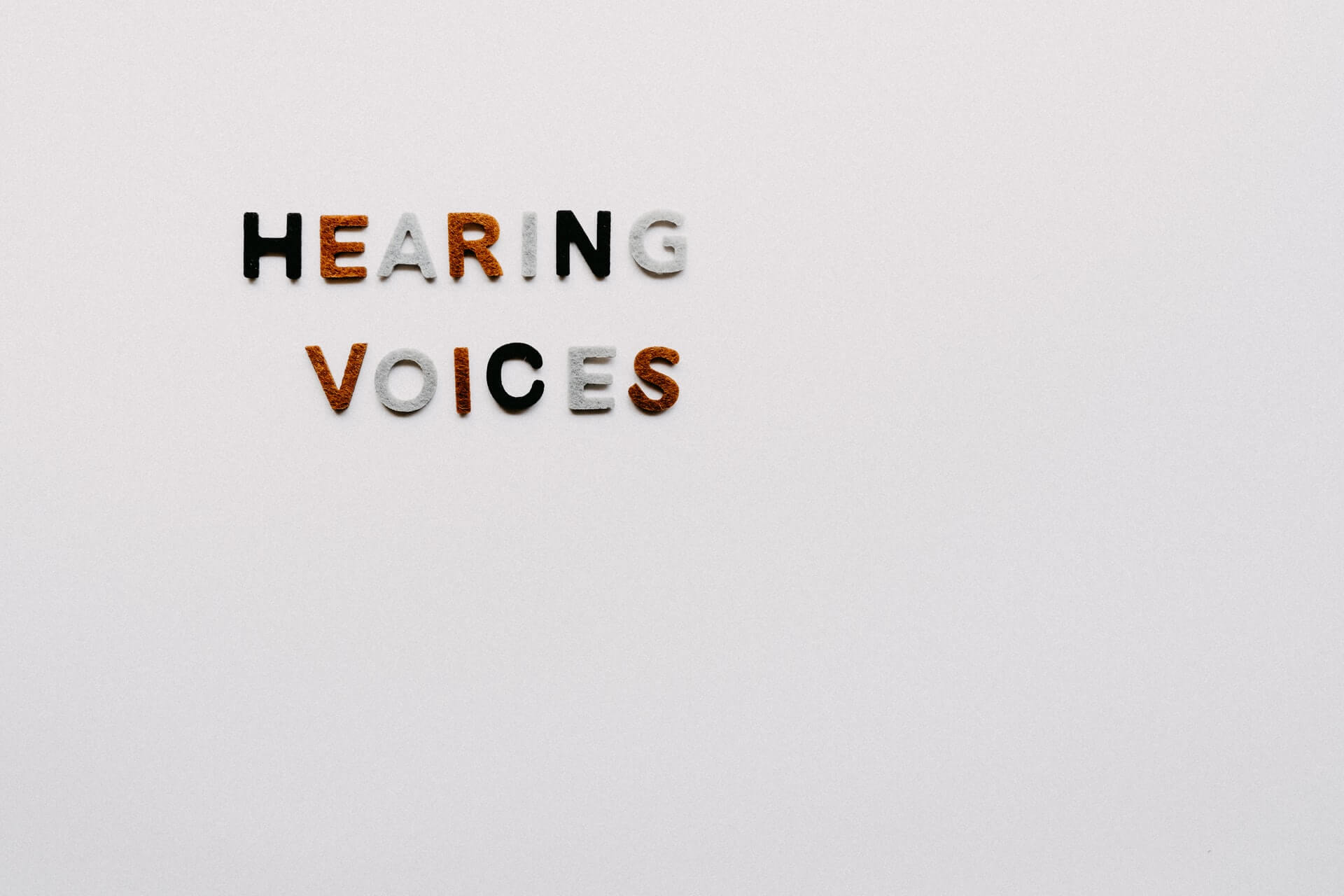 hearing-voices-head-sign-colorful-letters