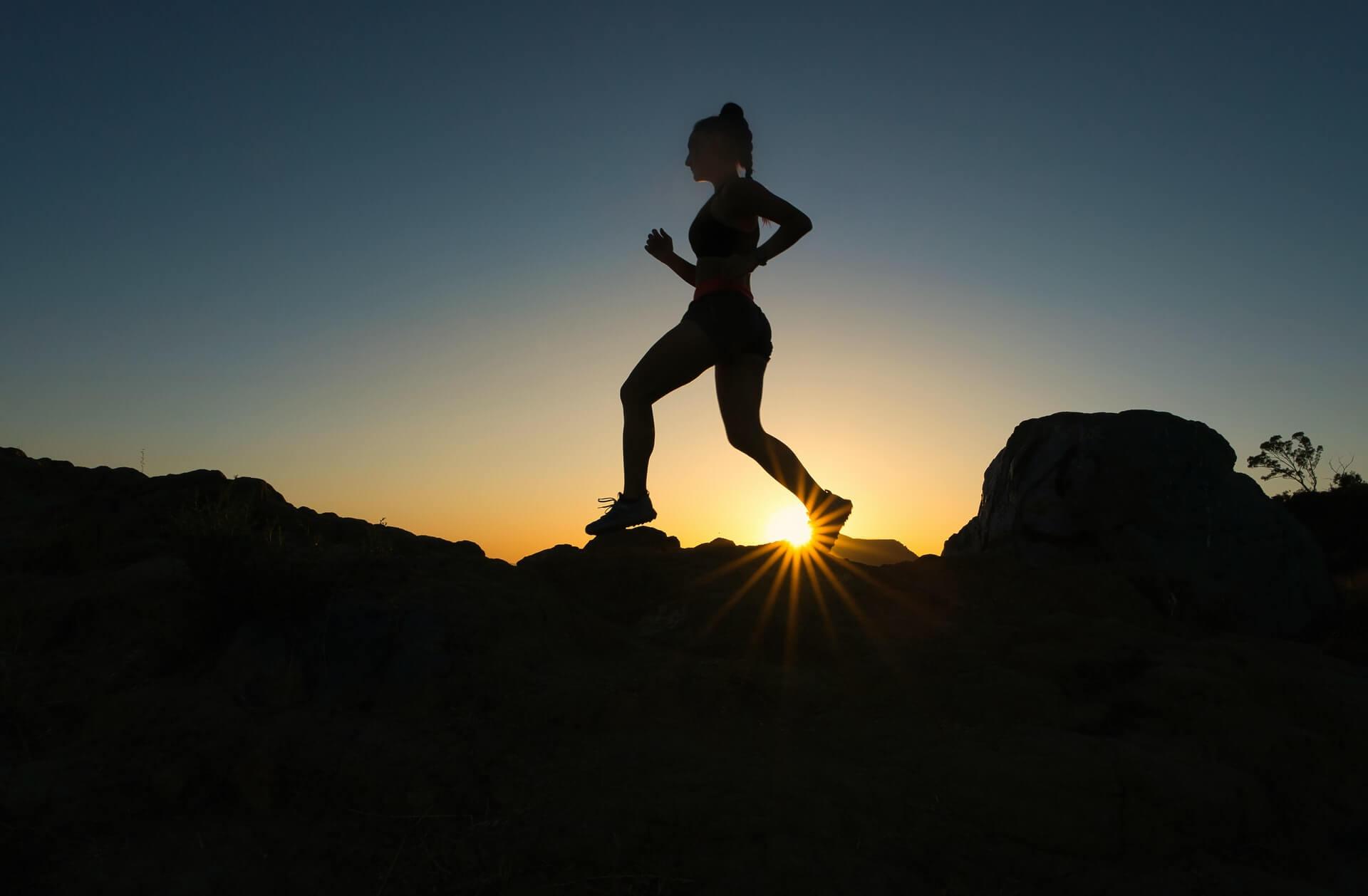 importance-self-discipline-motivation-woman-running-sunset