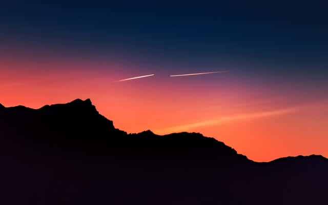 transitions-growth-mindset-colorful-sky-two-planes